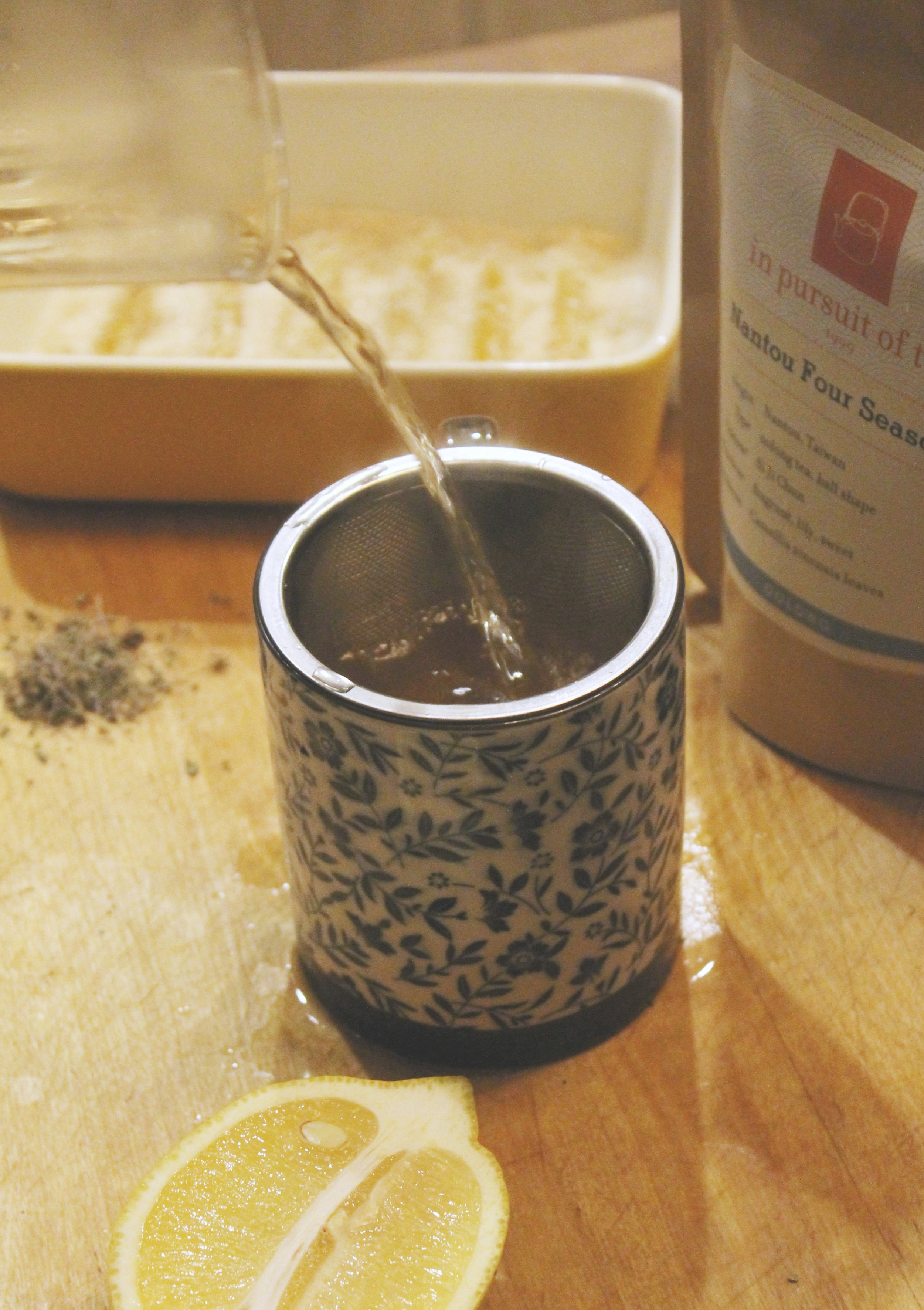 Serve immediately in mug using a strainer.Discard tea,basil, and lemon rinds in compost.