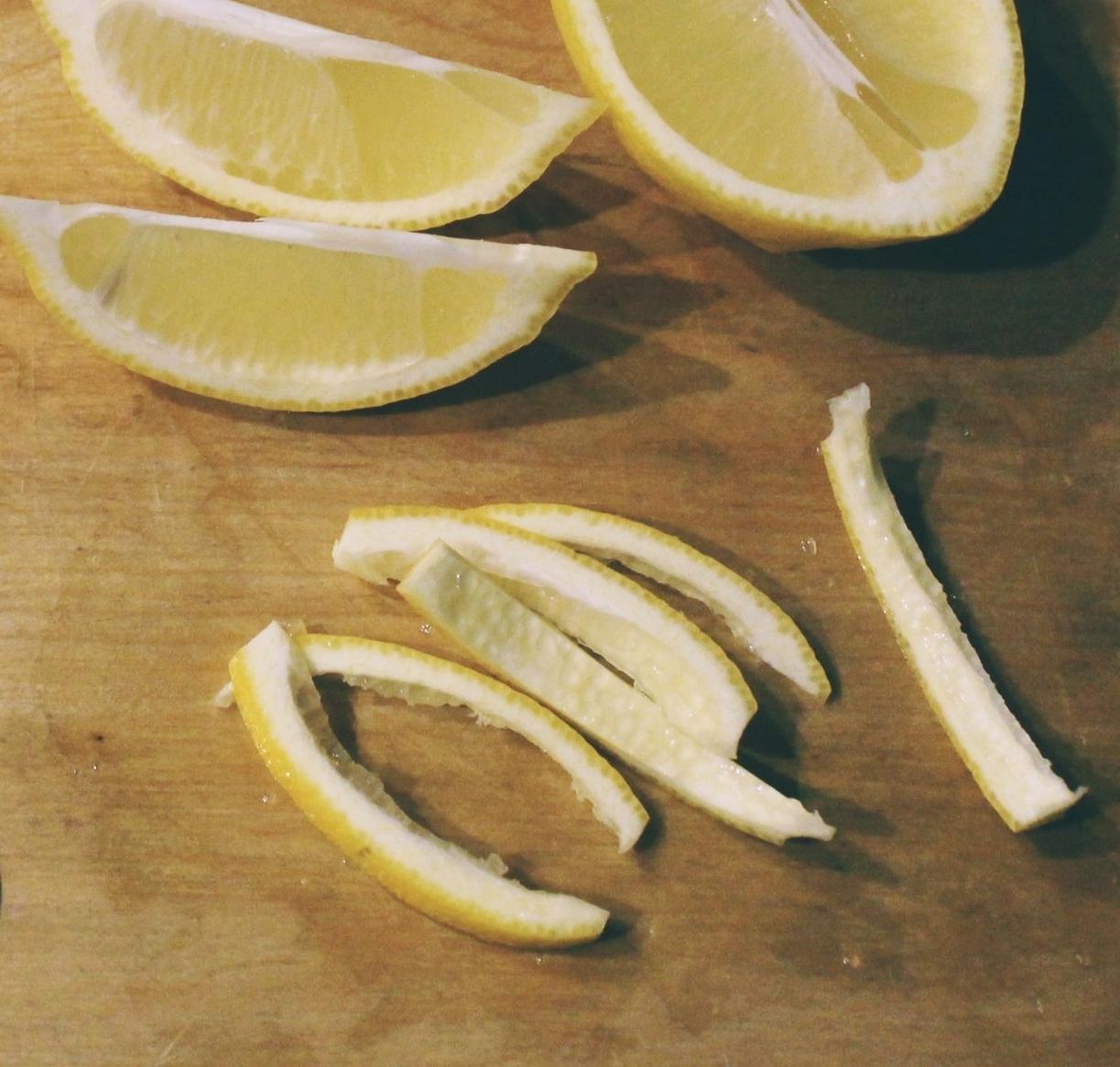Slice lemon peels in 2 in. strips.