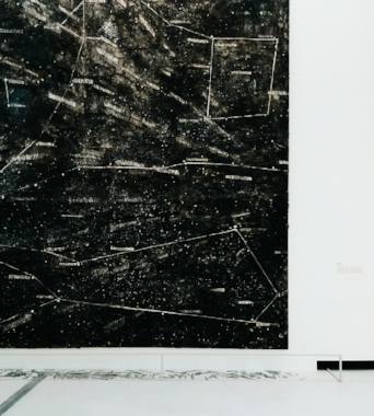 kiefer's night sky resembles an archive, where each star is identified by its code in the nasa classification system. lines traced to join disparate points draw imaginary constellations. at the foot of the canvass, on the floor, lie glass tabs with codes inscribed: they are the fallen stars, a bridge between the sky above and the ground below. comparison with the visual layout in the works entitled sternen-lager (star storehouses) suggests some reference to the holocaust, the numbered codes reminiscent of the numbers tattooed onto the arms of the jews at the nazi camps. the memory of post events entwines with cosmic visions. compositionally, the work is based on stratified pictorial matter and the fragmentation of formal elements.   sternenfall by anselm kiefer. 1998