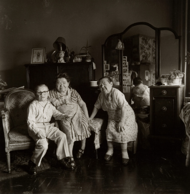 russian midget friends in a living room on 100th street nyc.1963