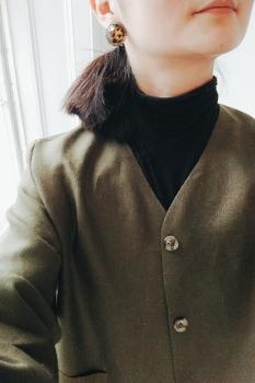 joi wearing irish linen top coat in moss green