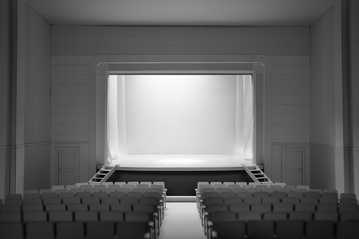 A small model that resembles an empty theater, facing the stage.