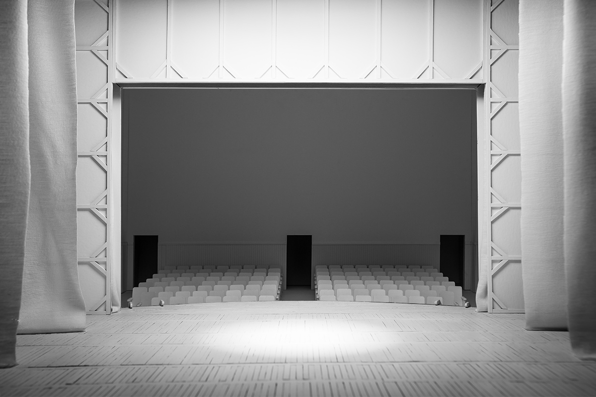 A small model of a theater, the perspective is from the stage