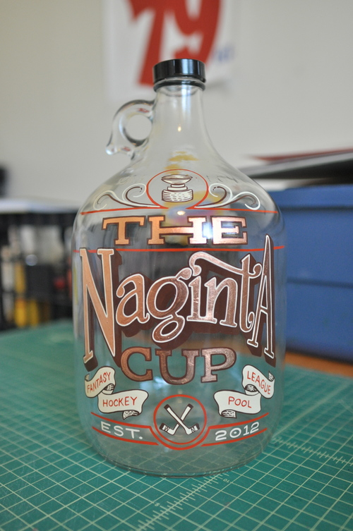 The Naginta Cup  was a fun project I just finished for a friend's competitive hockey pool. This was adapted from another design and re-jigged to fit the content. And metal leaf on glass adds some class!