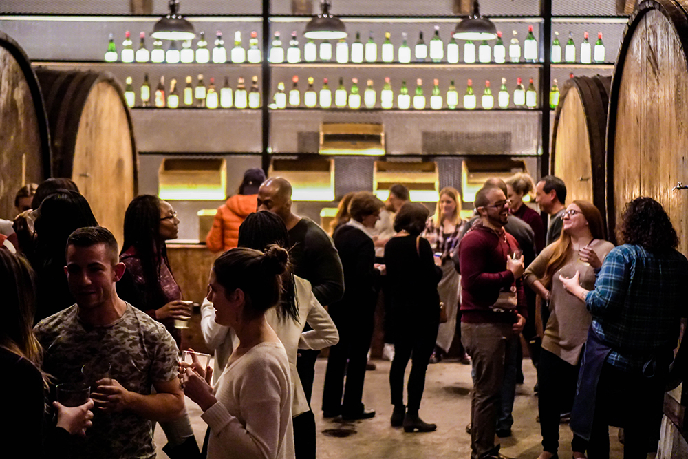 """The Barrel Room - This one-of-a-kind space is the heart of Brooklyn Cider House. Just picture your wedding ceremony, or cocktail reception in this one-of-a-kind space! Our huge, 80 year old chestnut barrels provide not only gorgeous, rustic decor to frame your event, they hold a variety of our Raw Hard Ciders. You and your guests can enjoy """"catching"""" cider directly from the barrels - it's an unforgettable and delicious - entertainment experience!"""