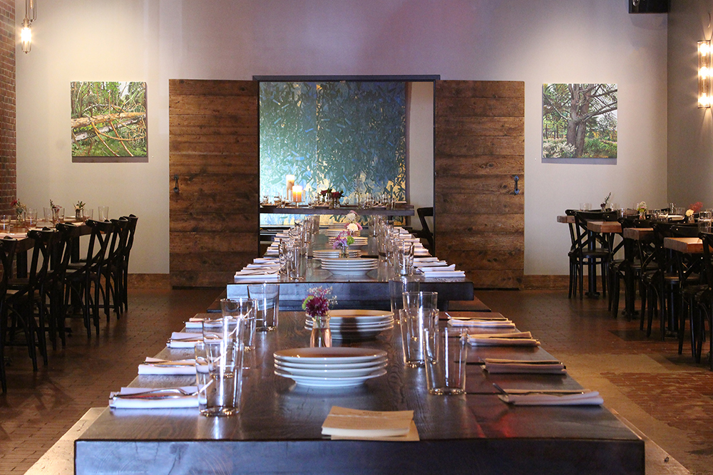 The Main Dining Rooms - Perfect for seated gatherings of up to 200 people, complete with reclaimed wood farm tables to make everyone feel welcome. We'll help you customize a menu to suit your tastes and budget, whether you're planning an elegant evening affair, or a more casual, family-style brunch or lunch service. For big, blowout events, we can clear the whole space to make way for your large cocktail party with passed hors d'oeuvres, or even a dance party!