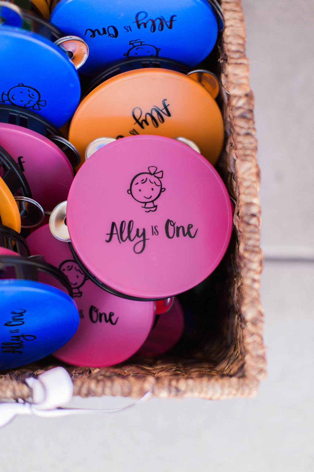 Bright, personalized tambourines served as party favors. Adorable!