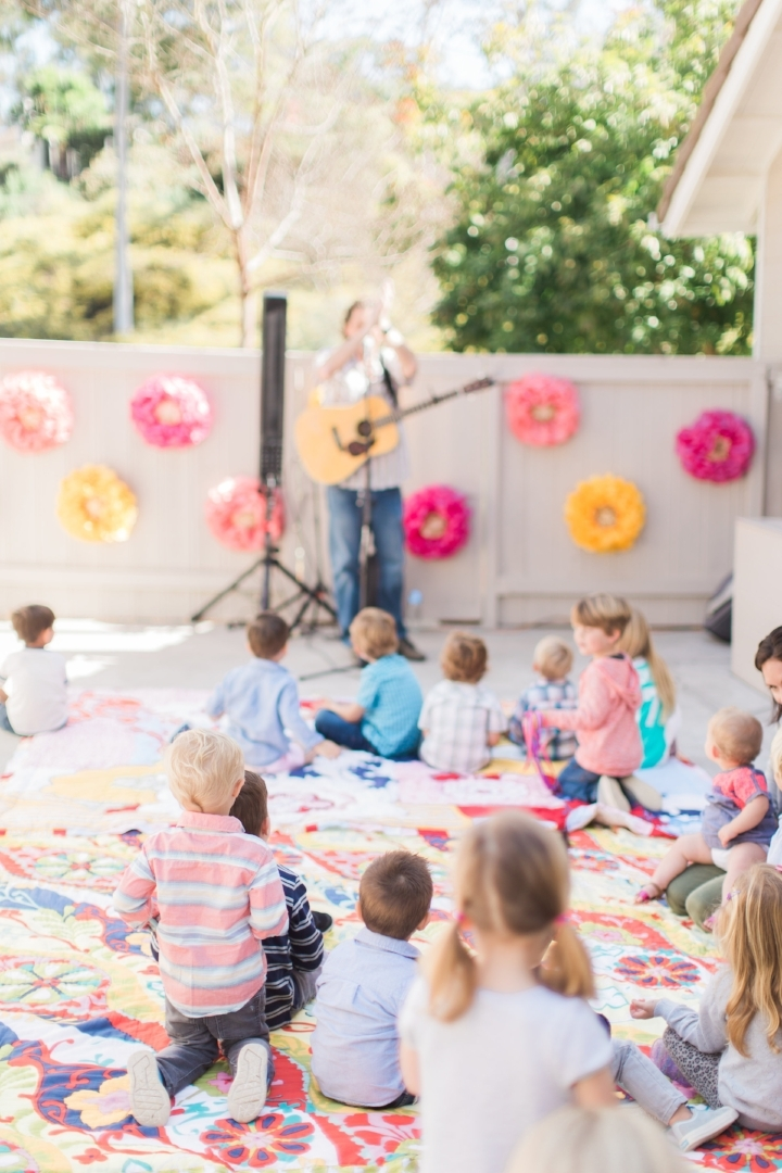 Little ones love music. Hiring someone to sing is always a great option, especially for a first birthday when some of the guests may be too young for other types of activities. Photo Courtesy of Amira Gray Photography.