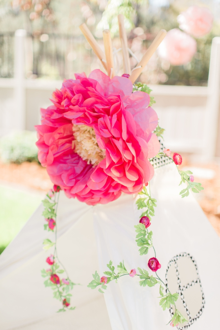 A recent client and I crafted up a bright and cheery first birthday that was equal parts boho and preppy. She used a paper-flower decorated tee pee as the photo booth backdrop which made for fantastic photos. Photo Courtesy of Amira Gray Photography.