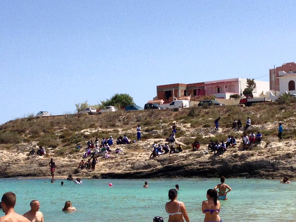 Refugees segregated at  Cala Guitgia , 3 July 2016.