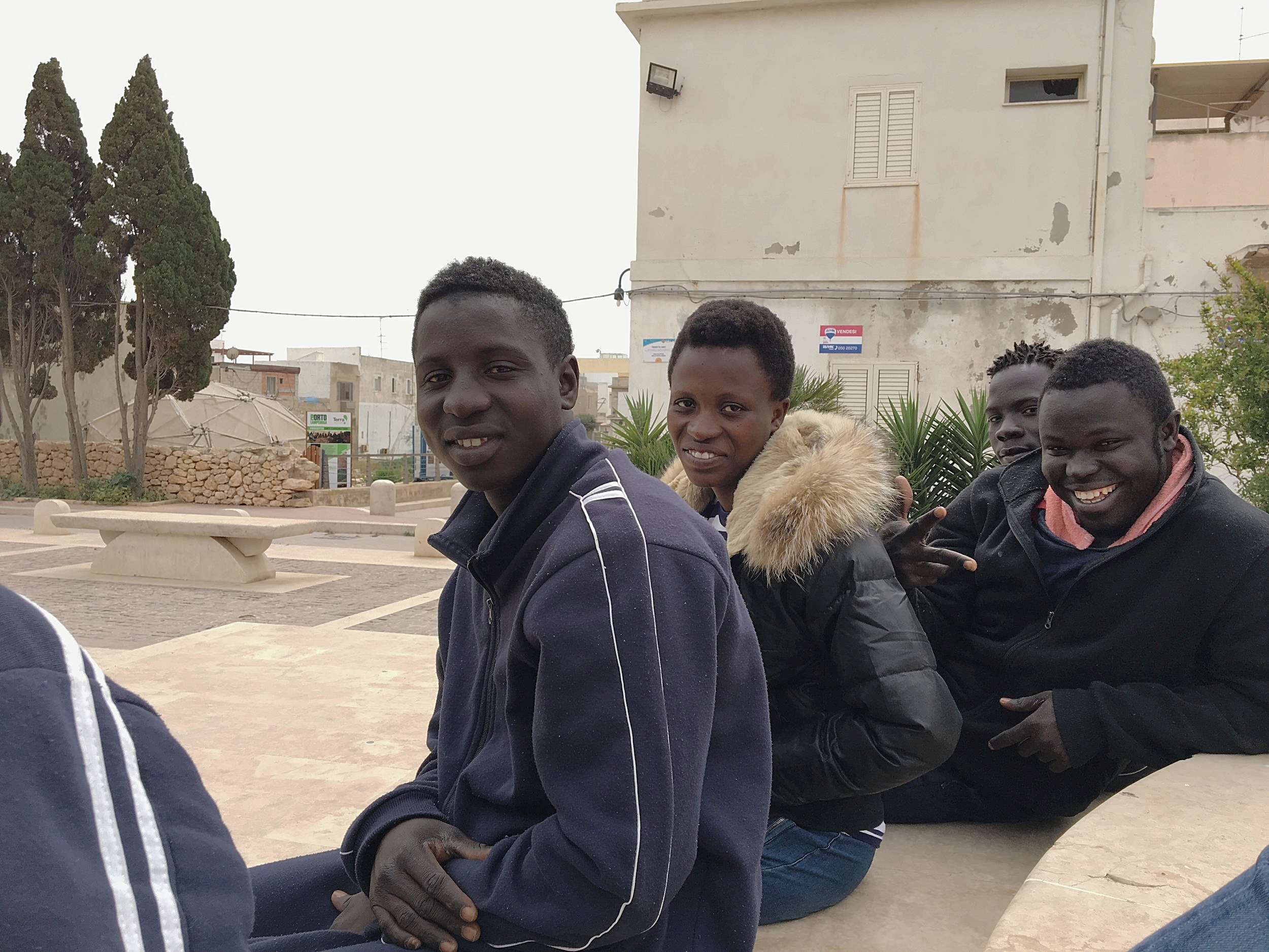 From left to right: Ousman, Fatou (22, Gambia), Yanks (20, Gambia) and Malick (17, Gambia). In Lampedusa, April 2018. © Pamela Kerpius