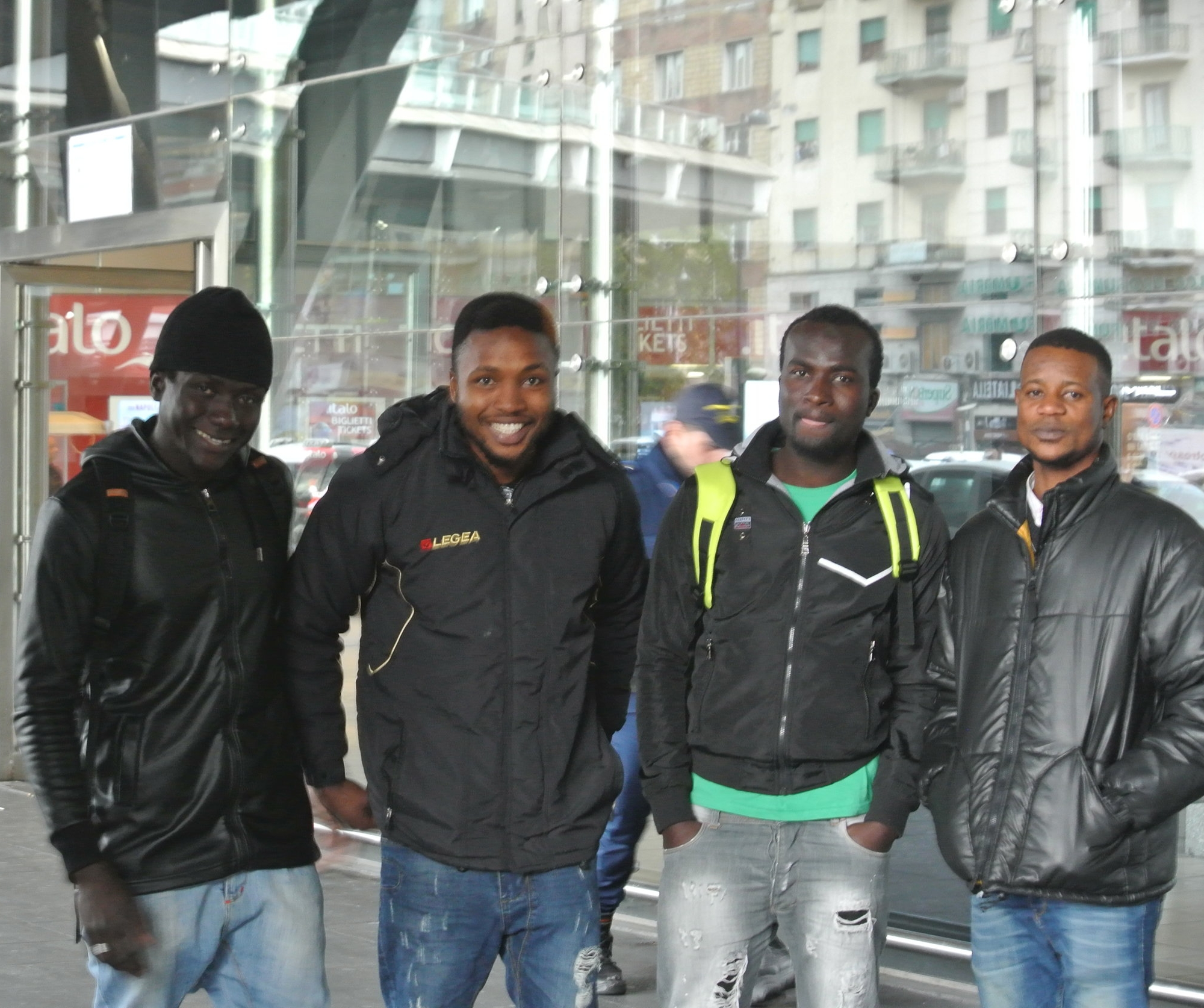 Left to right: Jamilu (20, Gambia),  Fabulous  (25, Nigeria), David,  Emmanuel  (21, Nigeria), at  Napoli Centrale  railway station. November 2017.