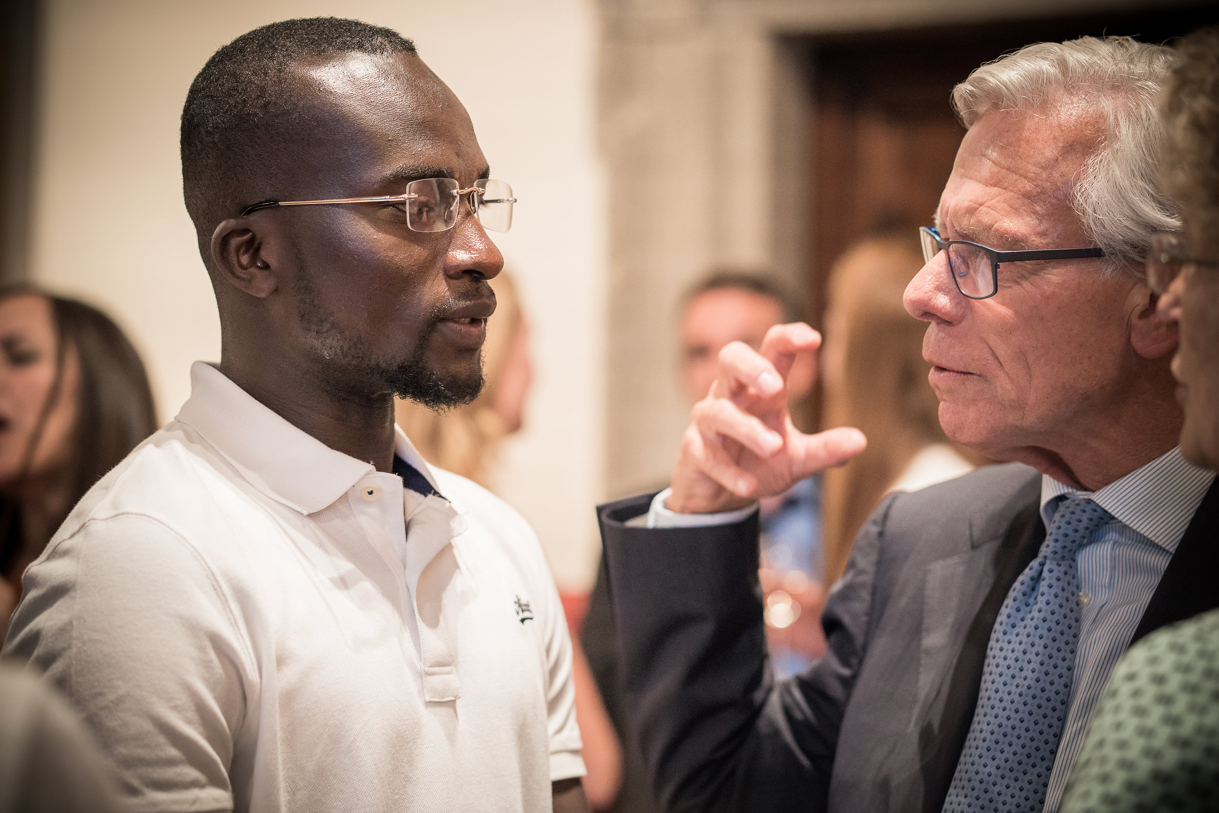 Bakary and Ambassador Knut Vollebaek, former Norwegian Foreign Minister talk at the Embassy of Switzerland, Rome. 11 June 2018. Image courtesy of  ICMP .