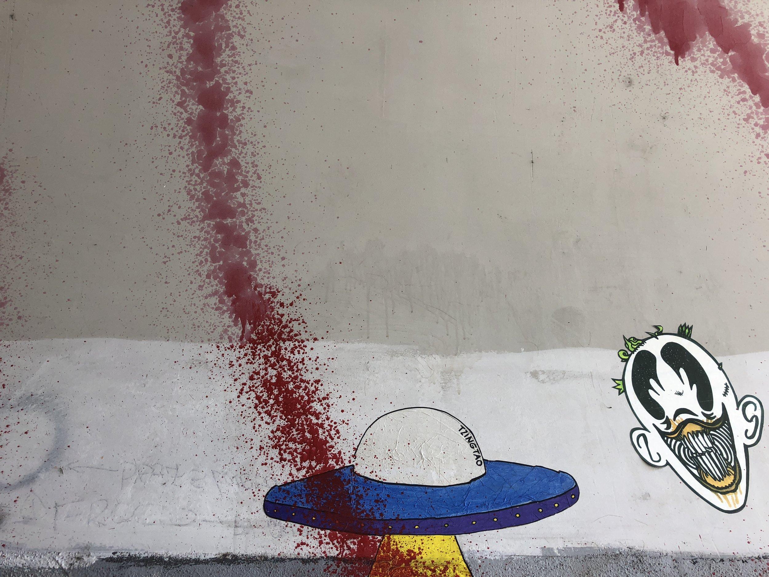 UFO: graffiti at a pedestrian portal. Rome, Ostiense; June 2018.  ©Pamela Kerpius