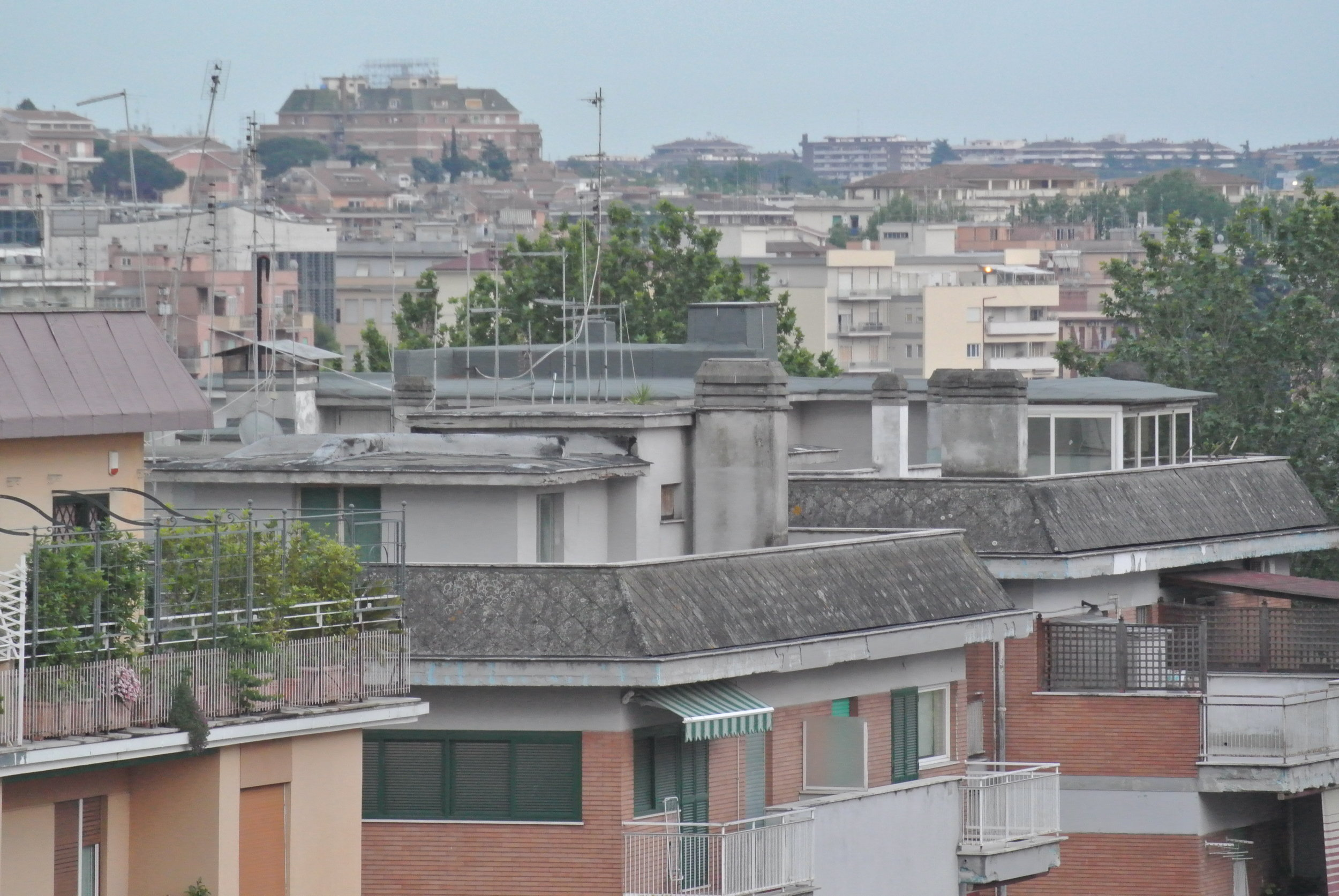 Spaceship Parking: rooftops ready for liftoff. Rome, Portuense; May 2018. ©Pamela Kerpius