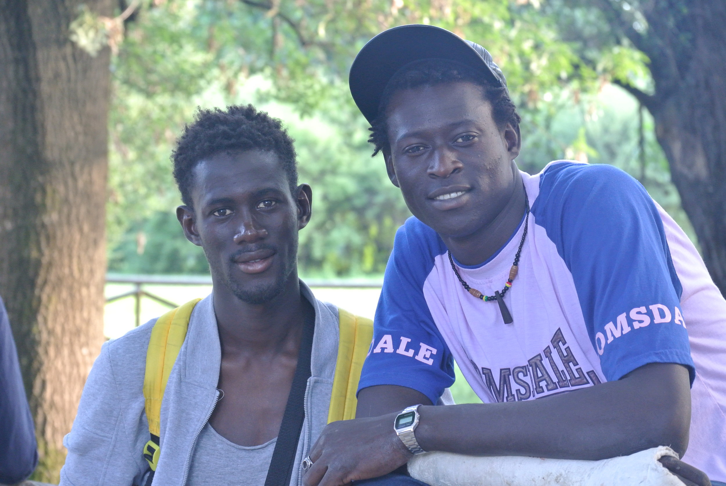 In the park with his friend Ebrima (Gambia). Milan, Italy; June 9, 2018. © Pamela Kerpius