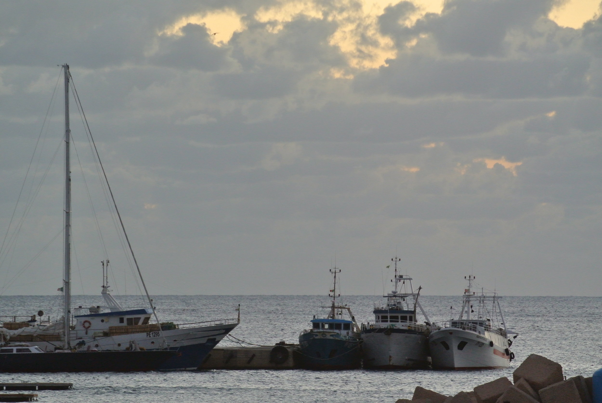 Fishing boats docked for weather. Lampedusa, Italy; October 2017. © Pamela Kerpius