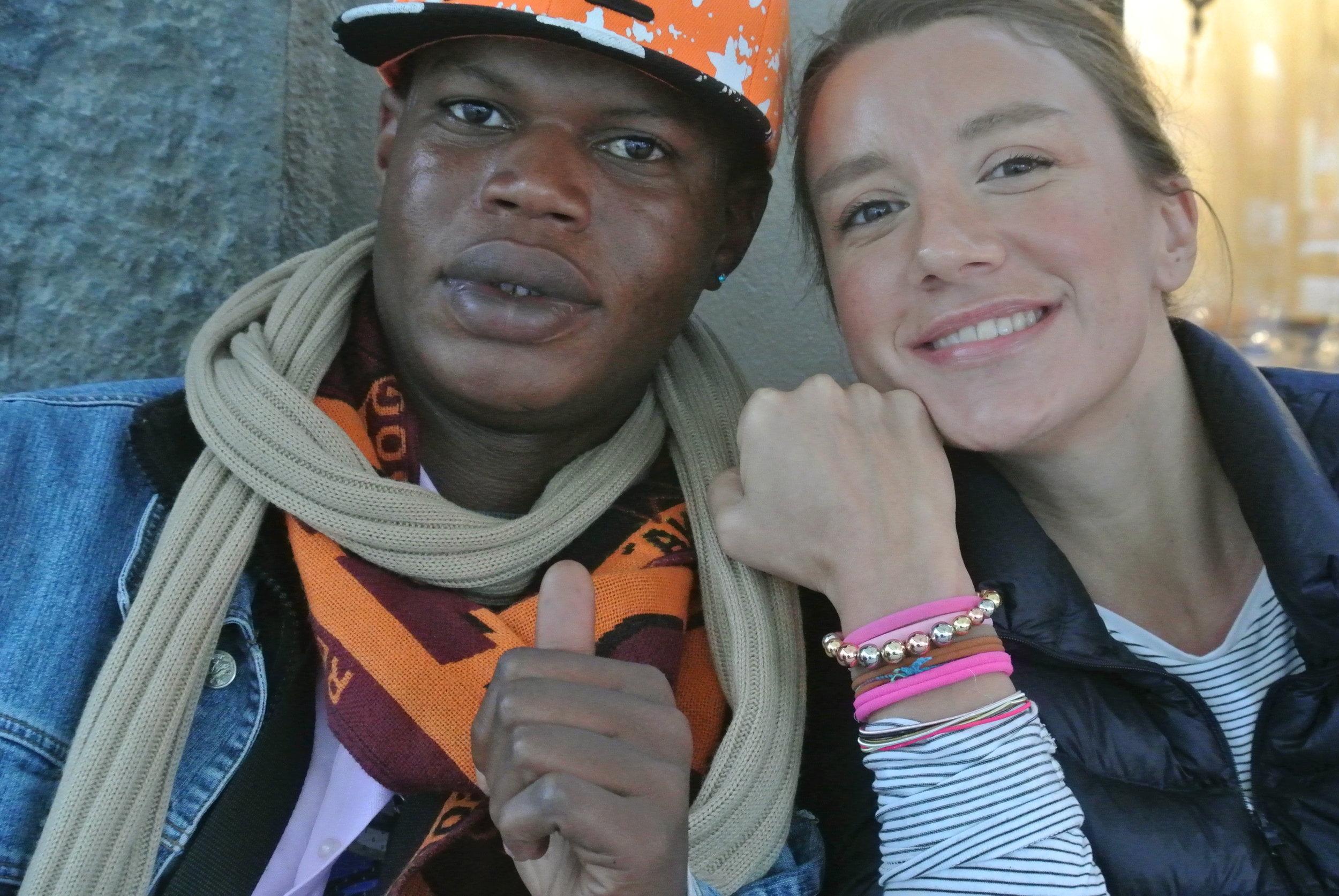 Yoro and the author wearing her friendship bracelet; Ousman, the photographer. In Napoli, November 2017. © Pamela Kerpius