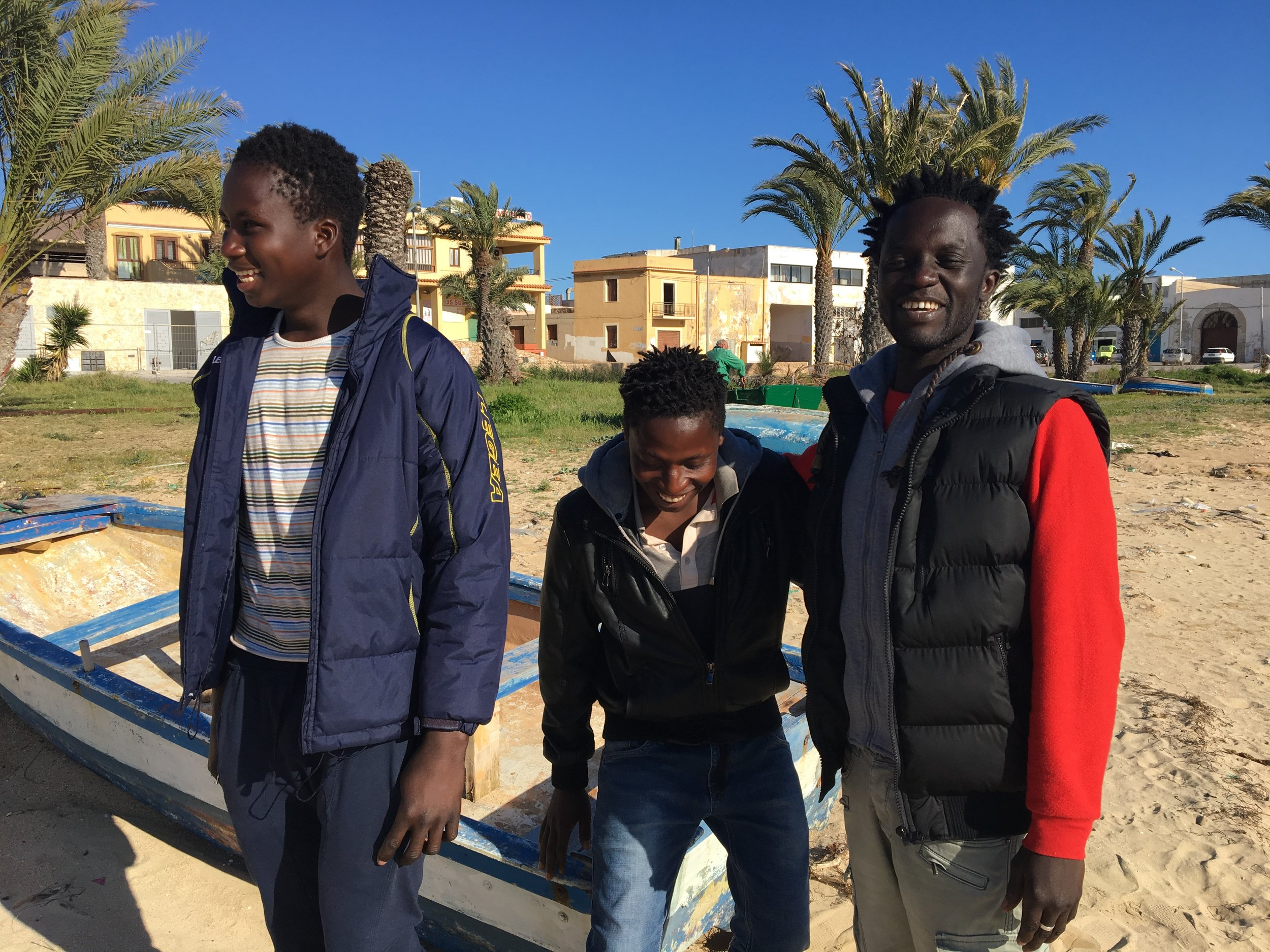Ebrima (L) at Cala Palme with his friends, 13 days after being rescued on the Mediterranean Sea. Lampedusa, Italy; 3 April 2017. ©Pamela Kerpius