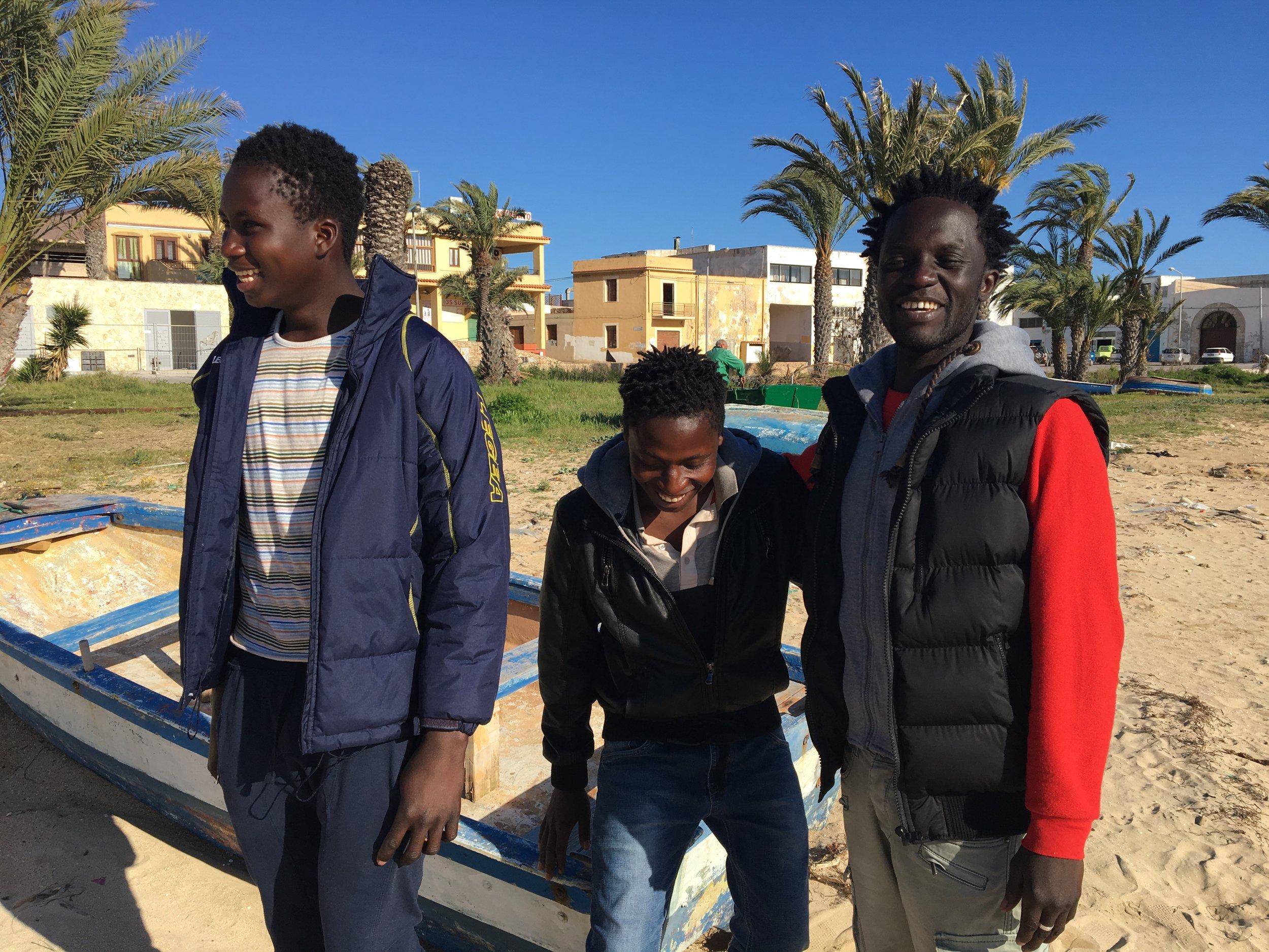 Ebrima (L) at Cala Palme; Lampedusa, Italy. 3 April 2017. © Pamela Kerpius