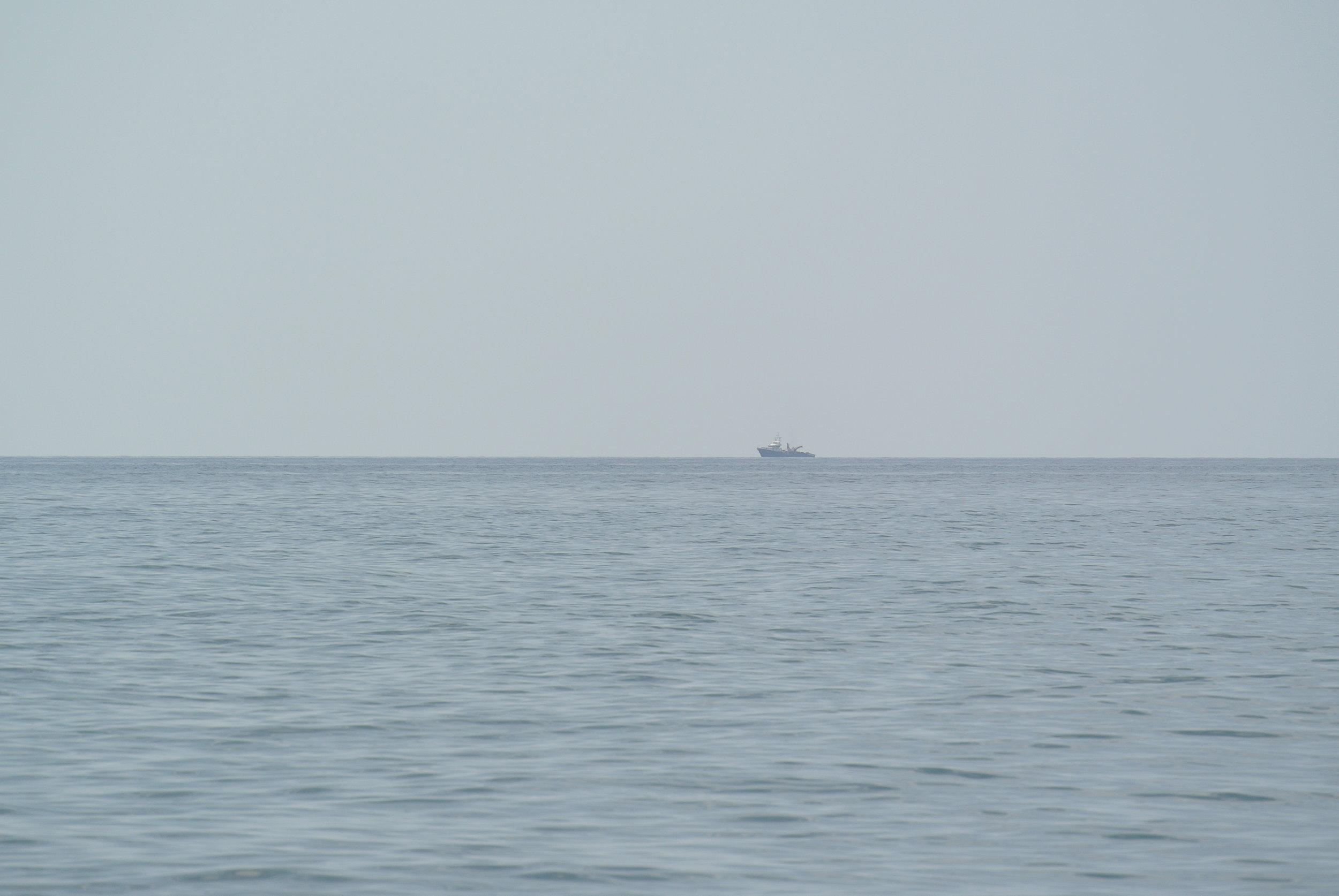 Ships on the horizon resembling rescue vessels. Longobardi, Italia; May 2018. ©Pamela Kerpius
