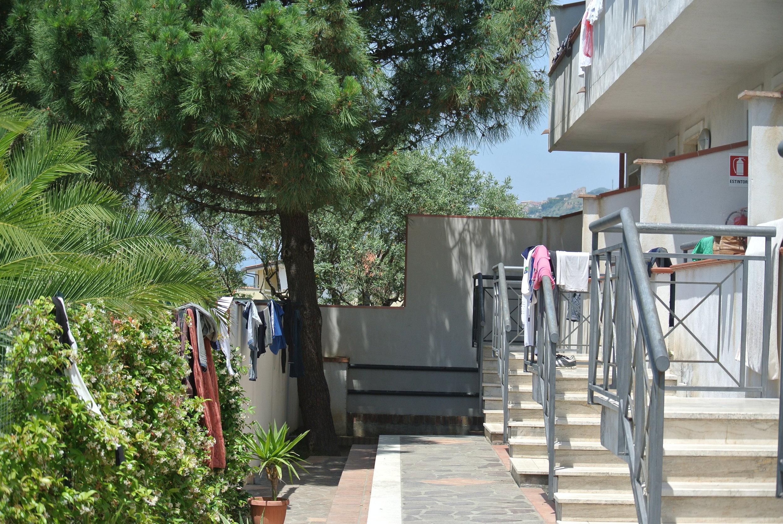 Laundry on the balconies. Longobardi, Italy; 30 May 2018. ©Pamela Kerpius