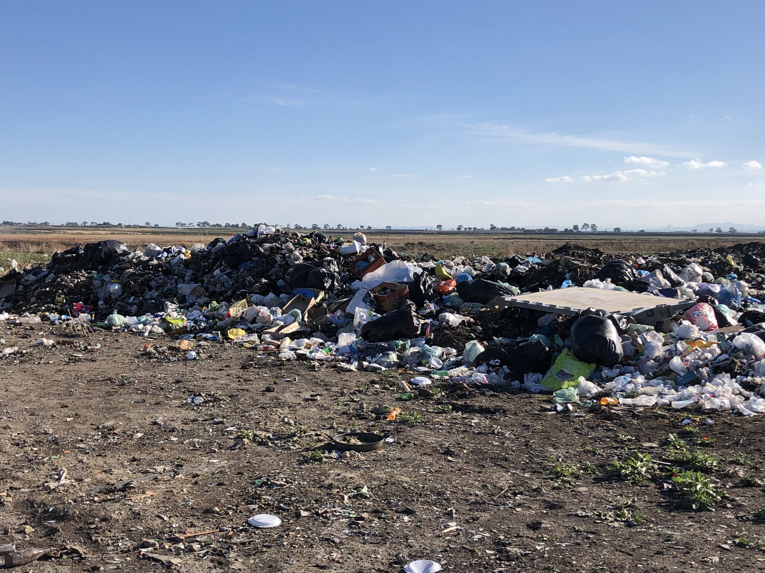 The trash heap behind the ghetto. Foggia, Italy. 8 October 2019. ©Pamela Kerpius