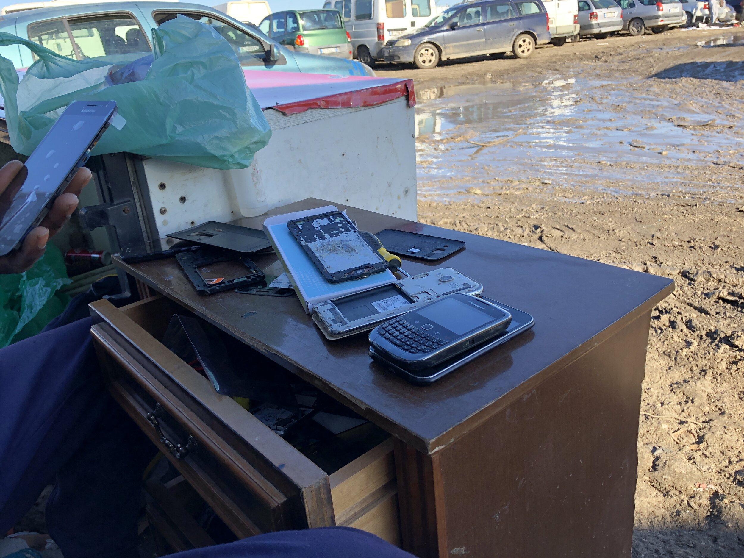 Open For Business: Amadou's* mobile phone repair shop in Gran Ghetto. Foggia, Italy. 8 October 2019. ©Pamela Kerpius