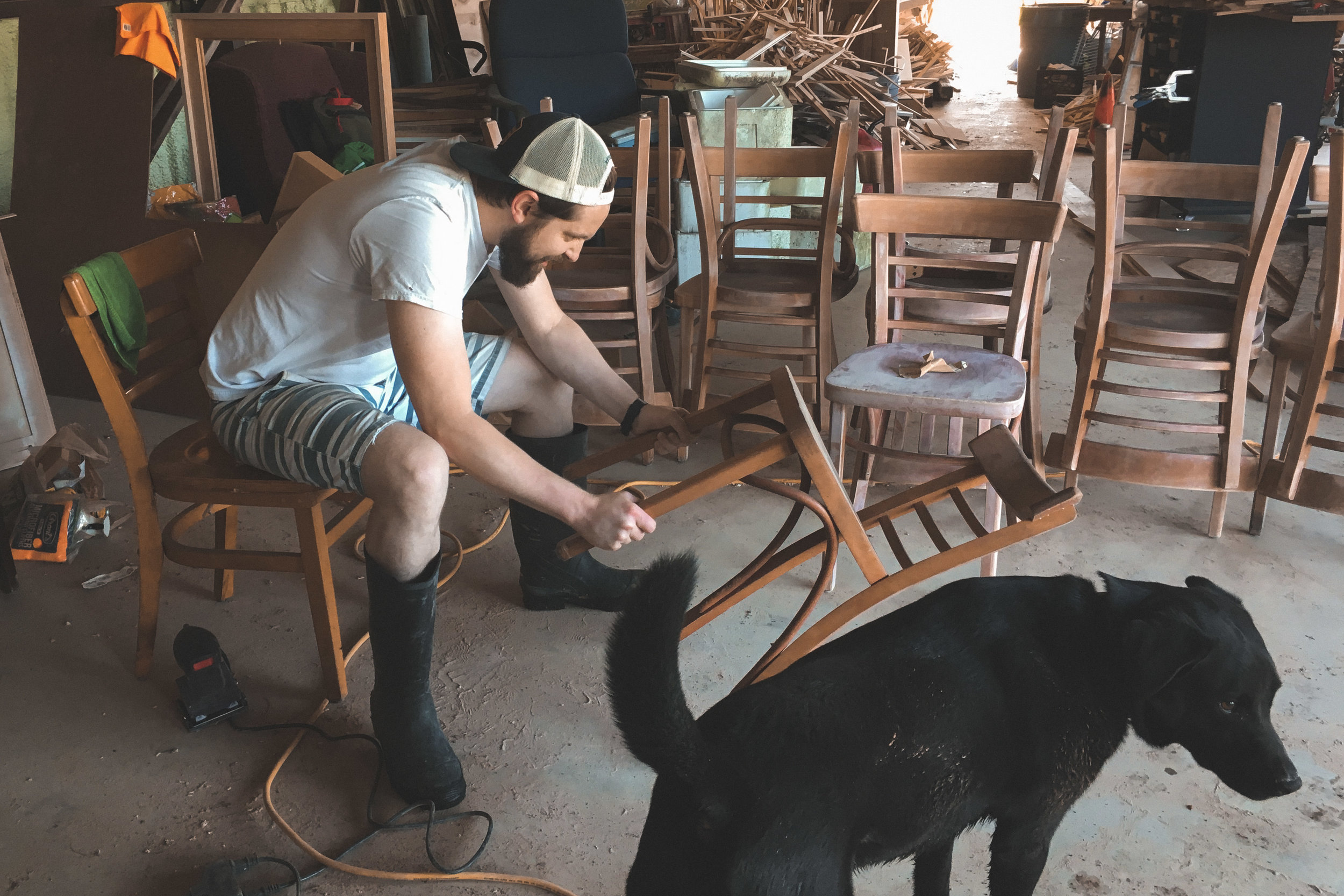 New Orleans_Miel Brewery_Alex refinishing chairs.jpg