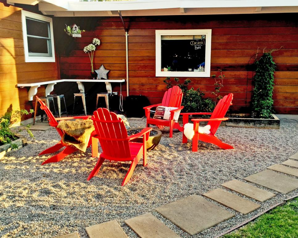 Budget-friendly pea gravel patio with fire pit and bar