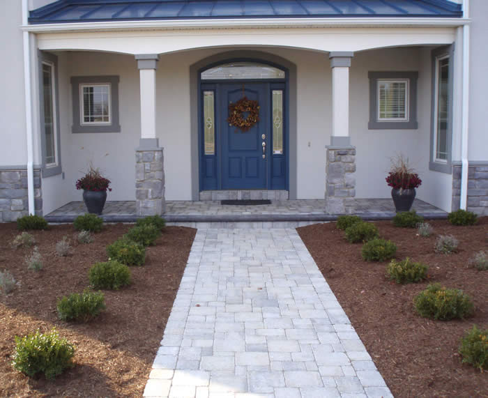 Pavers - Concrete can be a bore, extend your side walk or replace the steps on your front door for a more inviting entrance.