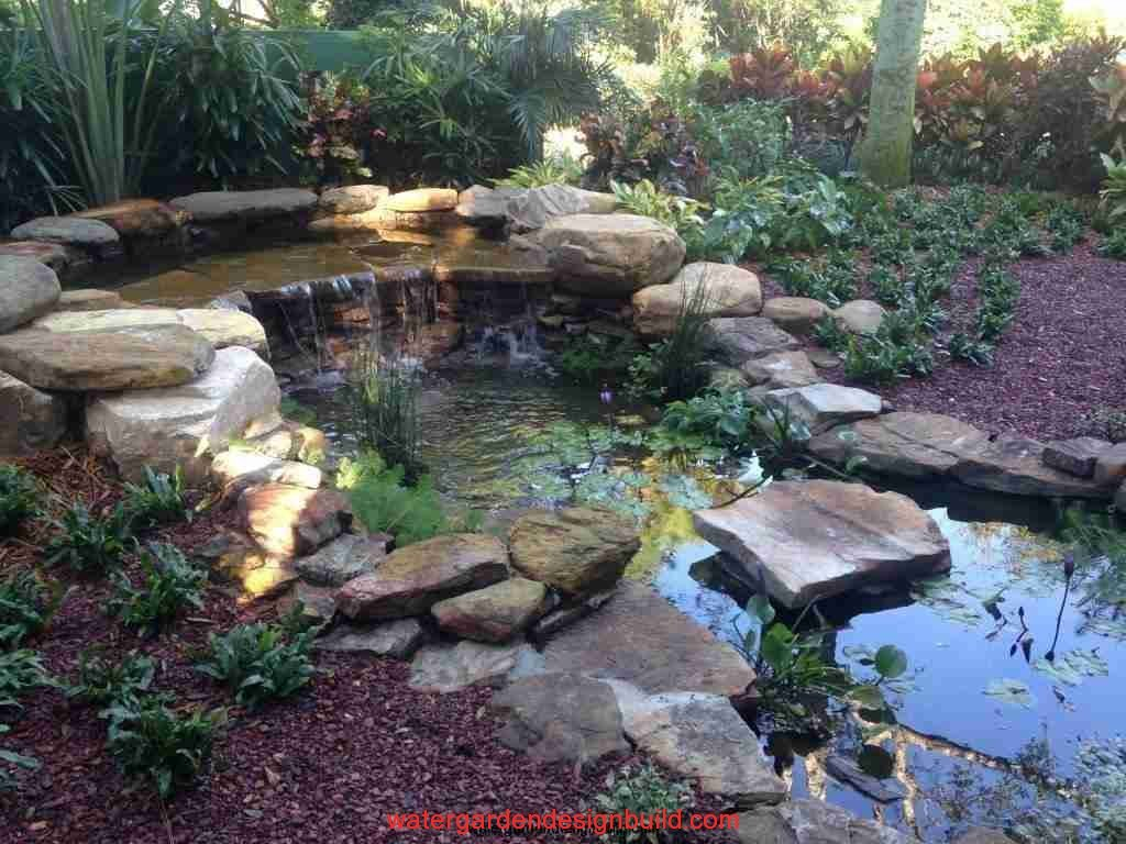 44-small-water-garden-with-large-falls-moss-fieldstone-and-river-rock-boulders990139.jpg
