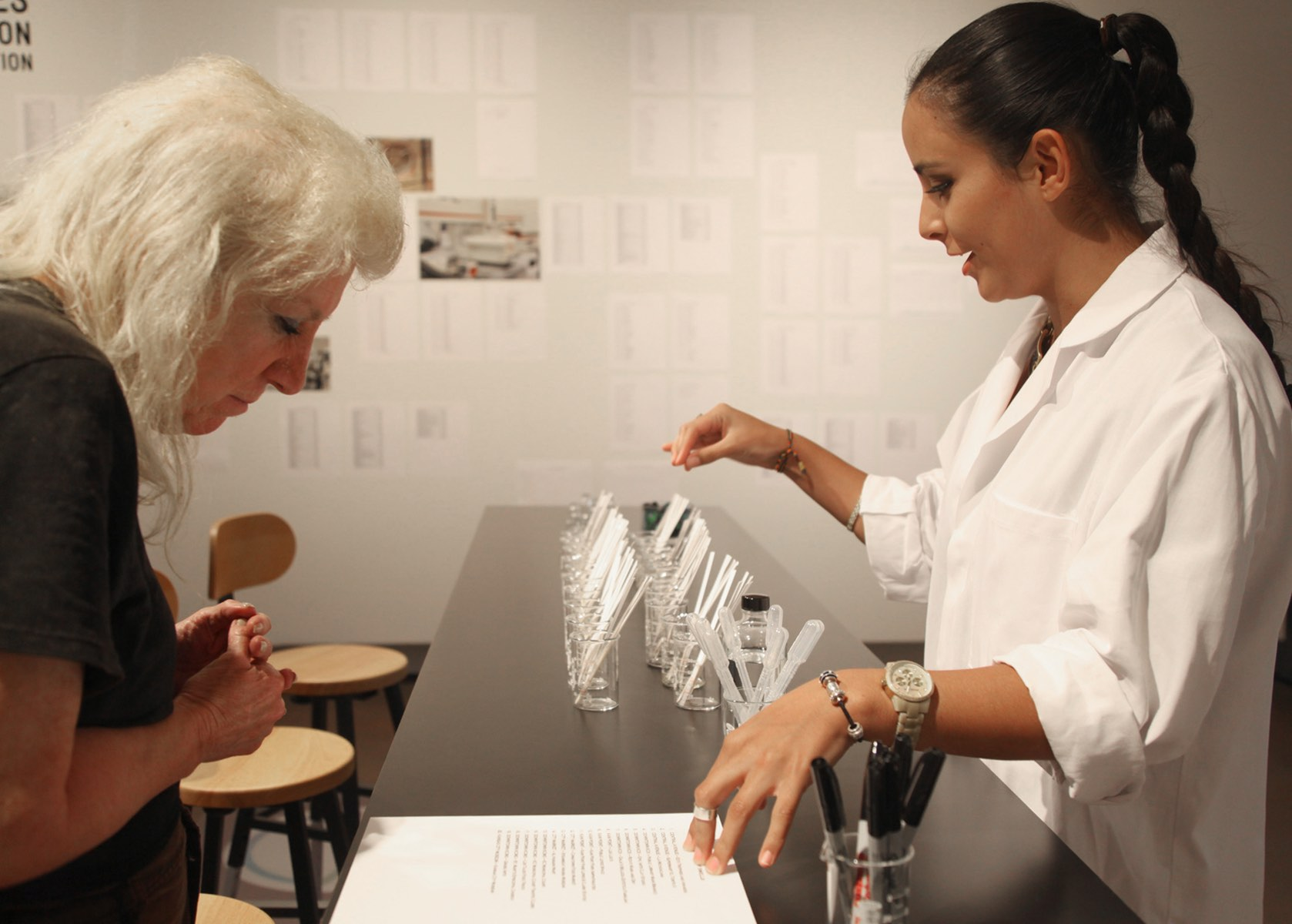 Grand Arts intern Carolina Aranibar-Fernandez helps a visitor at the smell micro-lab, 2012.