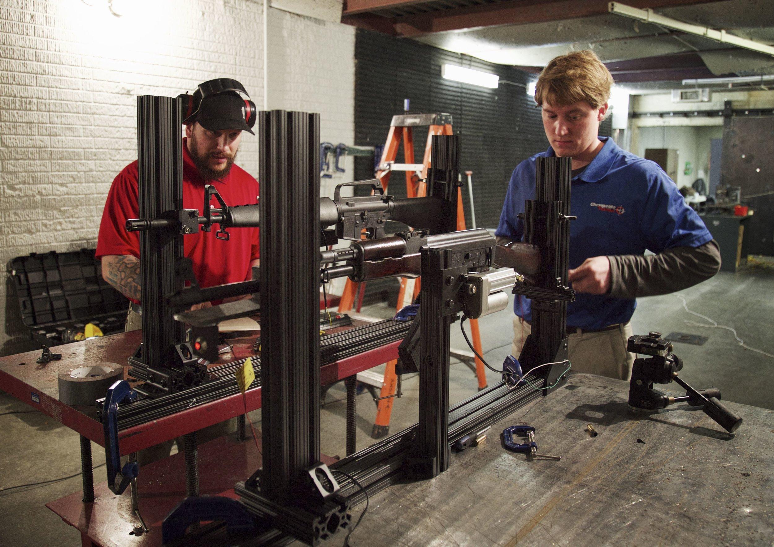 Chesapeake engineers prepare the rifles for ballistic testing