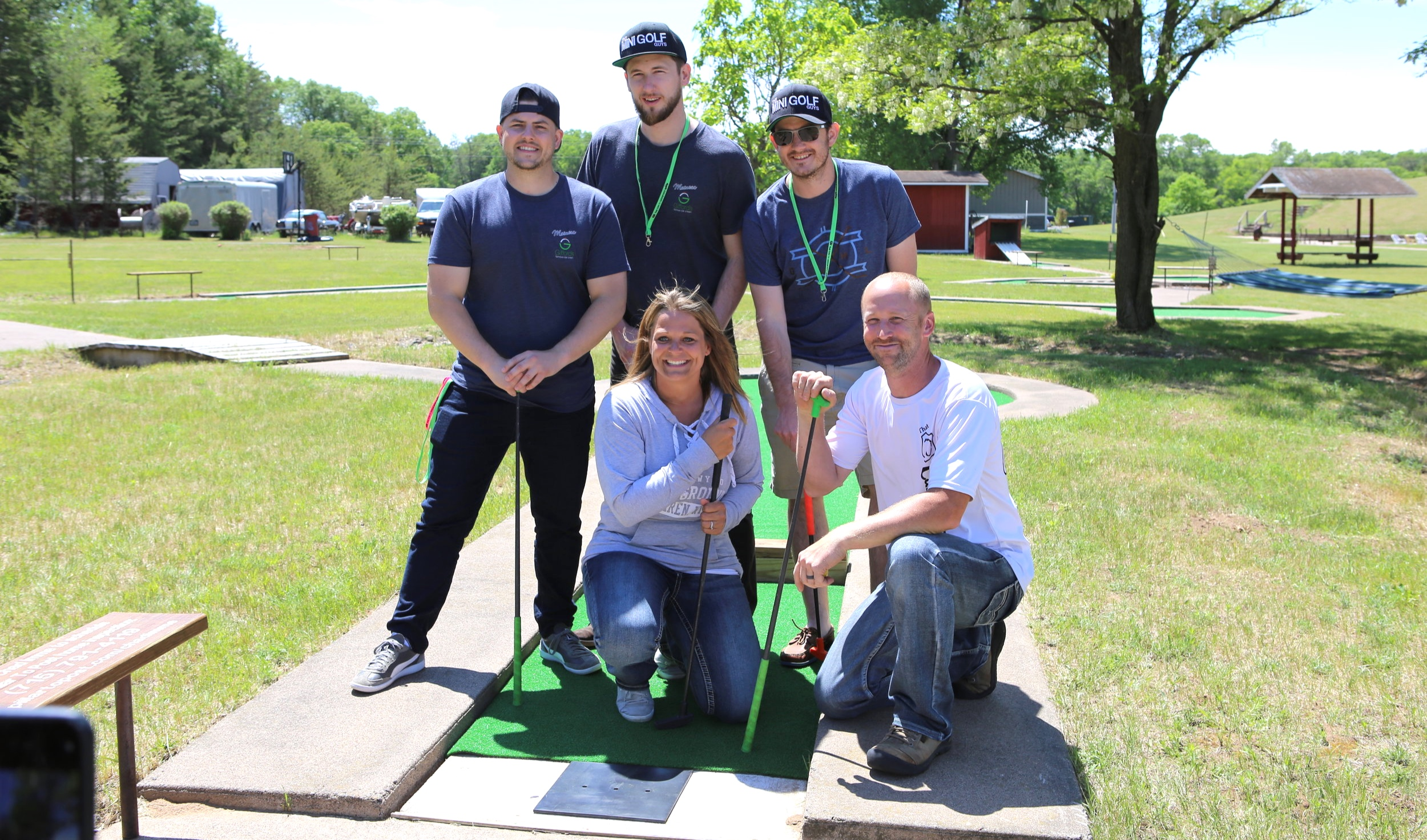 The Mini Golf Guys pose for a photo at That Highway 70 Campground in Siren, Wisconsin with the new owners. The course reopened this summer after decades of being defunct. It was the first course The Mini Golf Guys ever played as a group.