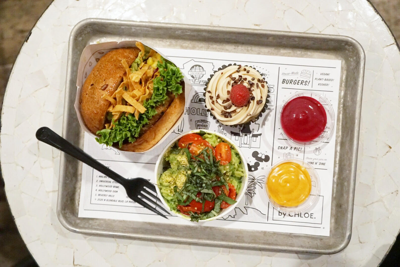 Vegan burgers and avocado pesto pasta at by Chloe
