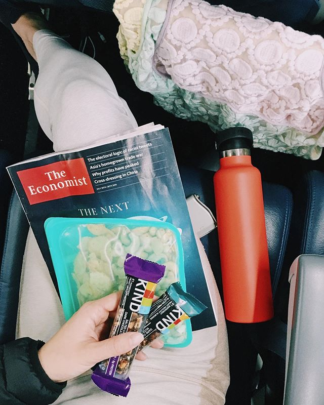 night flight done right: good reads, excess hydration (SO PARCHED after utah), killer snacks AND live action alladin in-flight entertainment?!? does it matter the flight back to seattle is only 90 minutes? is this an excessive amount of snacks? nahhhhhh. . feeling so content after an amazing weekend in utah to celebrate a friend's wedding ! these guys @kindsnacks came through as the real MVP on the 27 miles of trails we hiked 🐒🐒🐒 (#ad) this month they sent me a ton of salted caramel + dark chocolate, and i kid you not: they taste like snickers 🤯 and you all know i love a good snickers at the summit 🏔 hope everyone's tuesday isn't tooooo brutal 🙈 #sendnaps . #KINDcollective #beKINDtoyourself