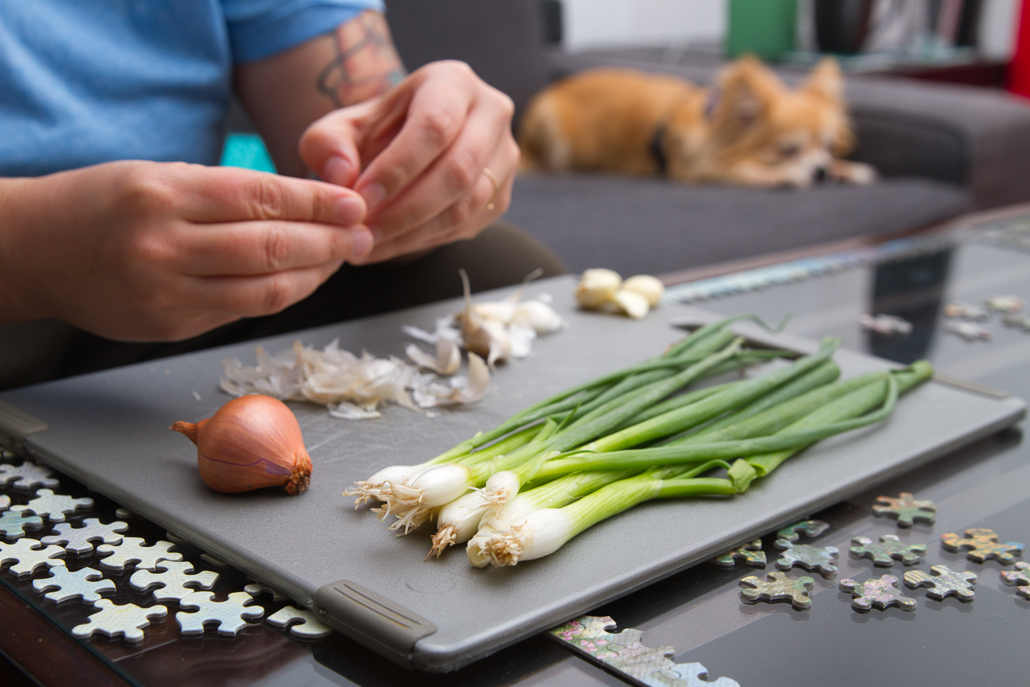 I love this image of my amazing multitasking wife prepping delish food atop her puzzle while watching the Olympics and being supervised by our grumpy chihuahua.