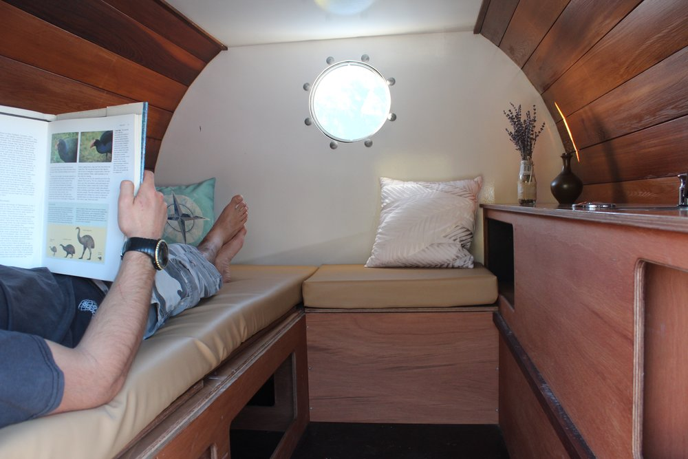 Interior of The Barrel self contained camper showing sofa.jpg