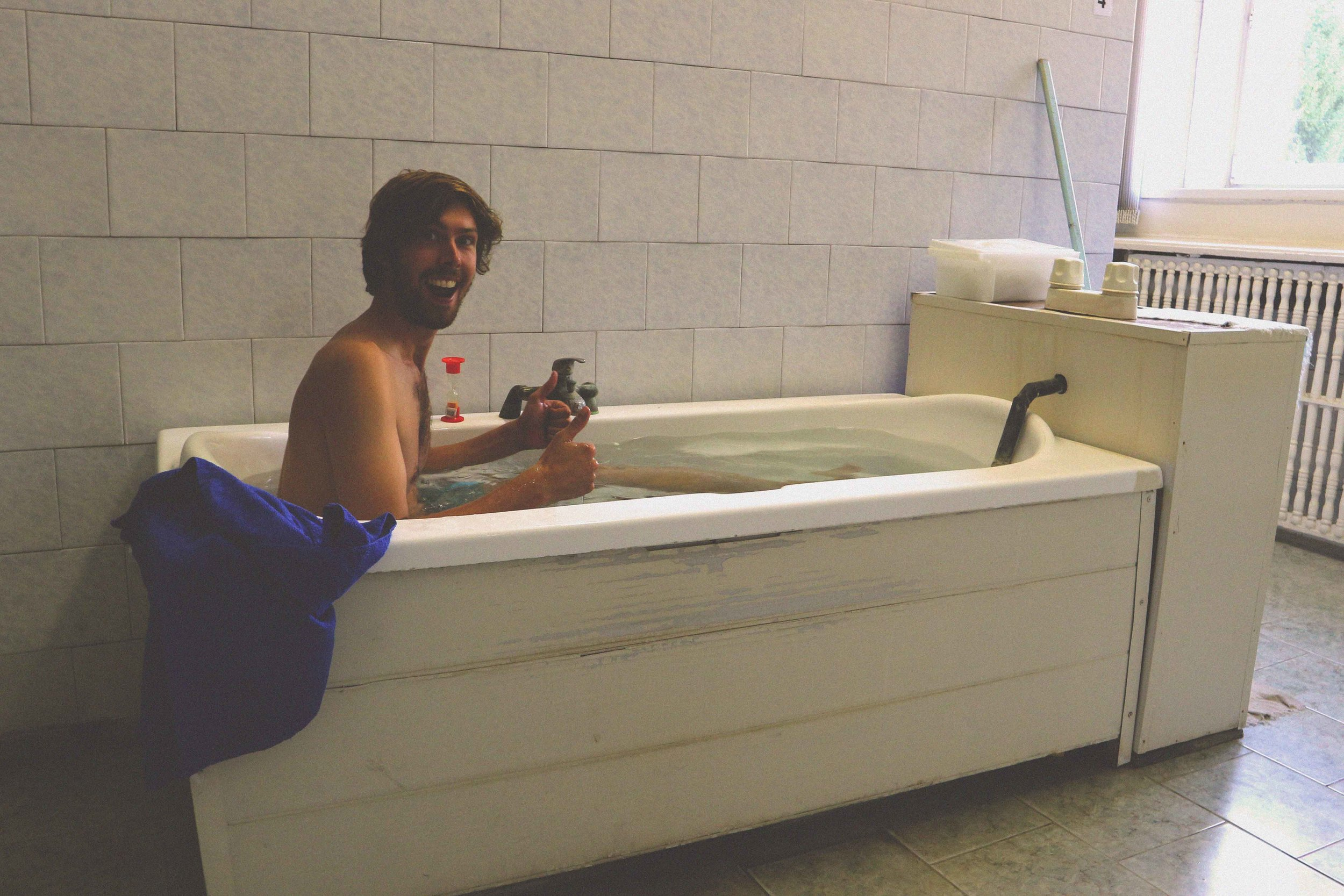 Mark bathing in the hot mineral bath
