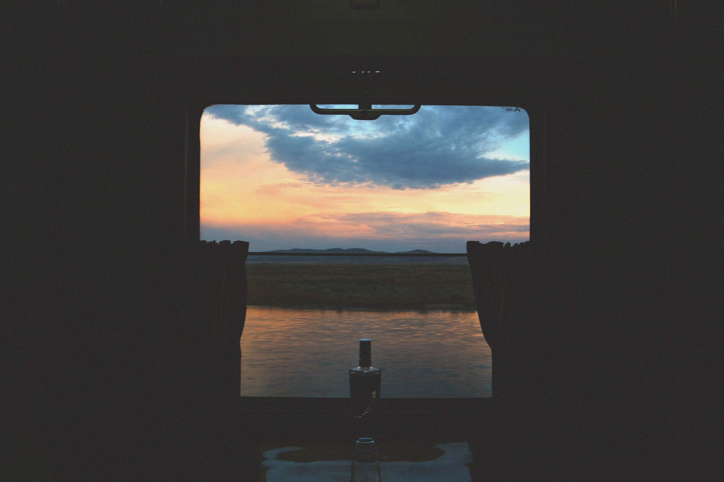 Window view of sunset on the Trans Siberian Train, Russis
