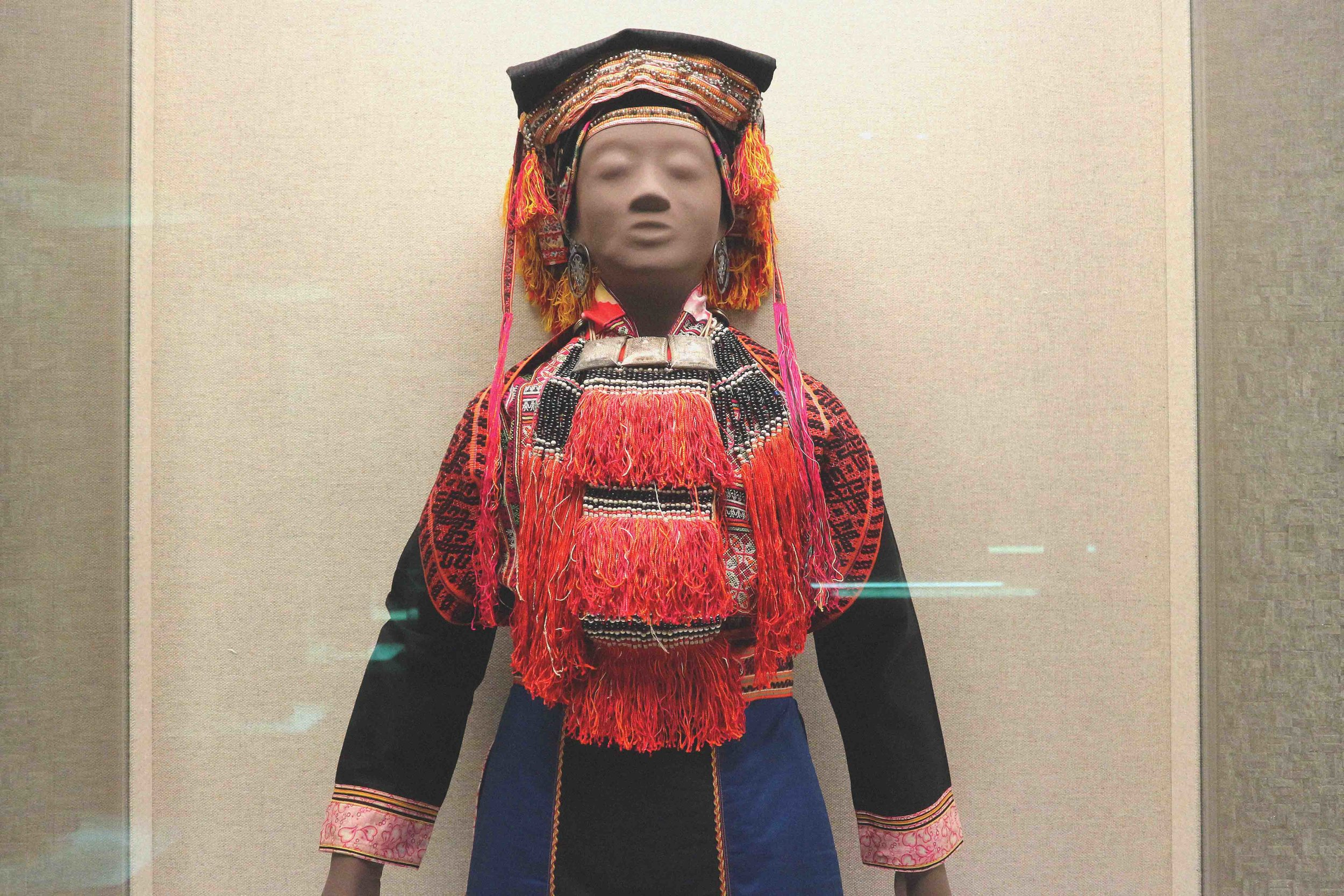 Traditional Chinese costume featured in the 'Arts and Crafts by Chinese Minority' exhibition