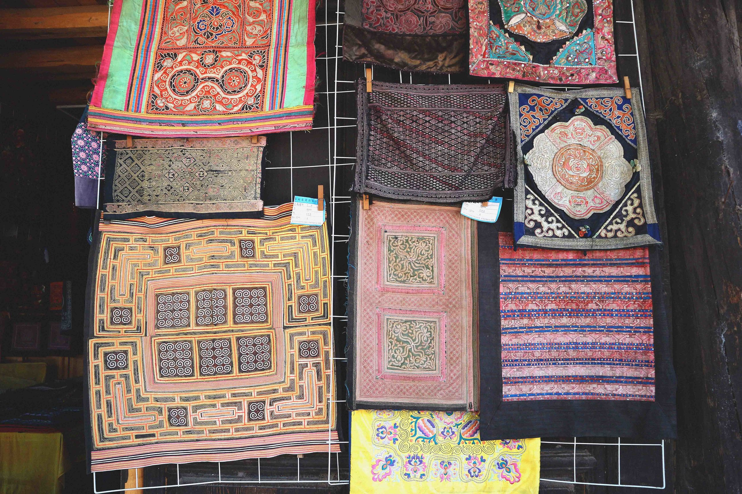 The hundred of antique embroideries for sale in Basha, all priced at a few hundred dollars a piece