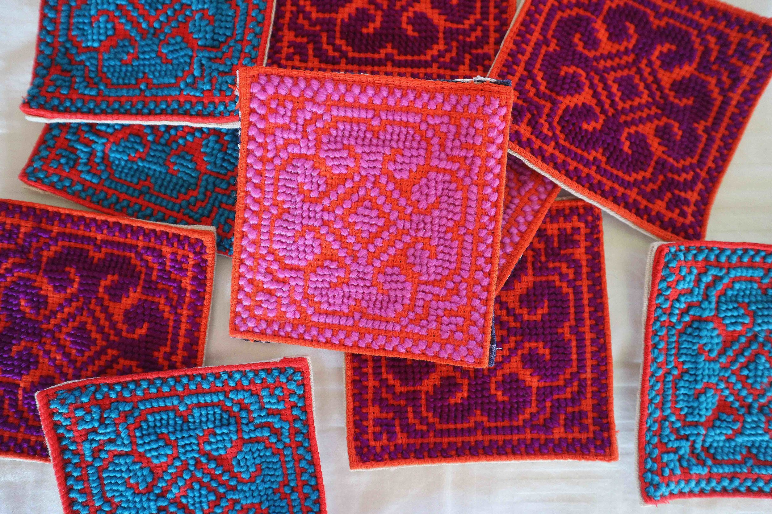 Newly produced hand cross-stitched coasters.  These are very quick to produce for the skilled locals. They were 75p each