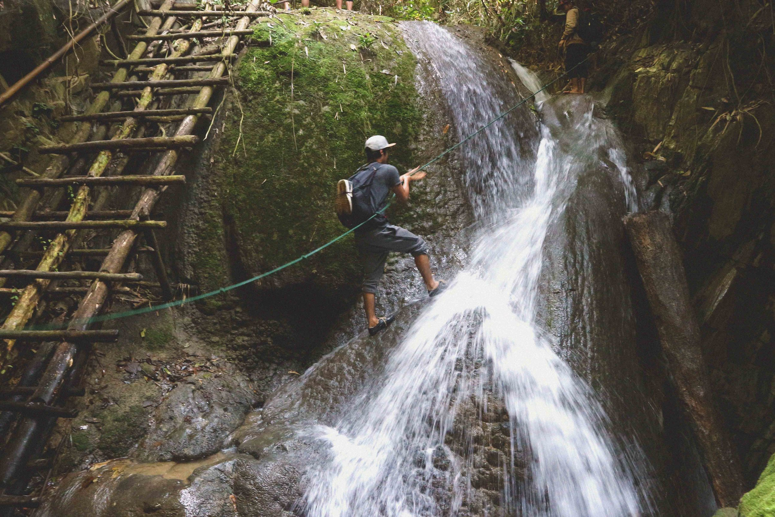 Climbing one of the 100 waterfalls