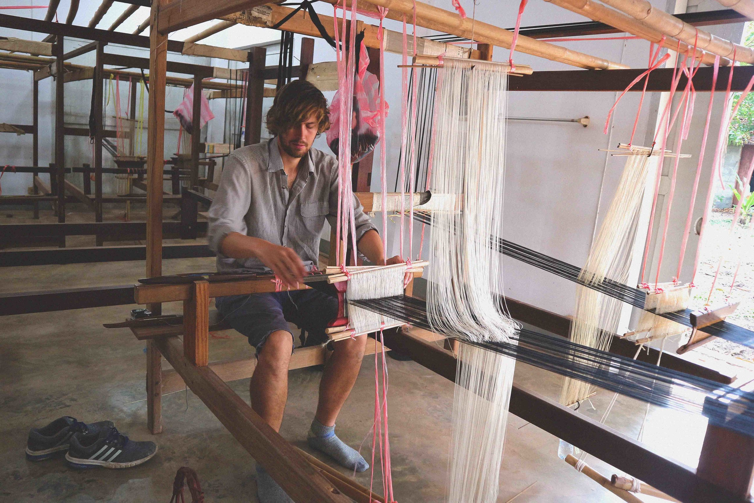 Mark learning to weave at the Houey Hong Vocational Centre For Women