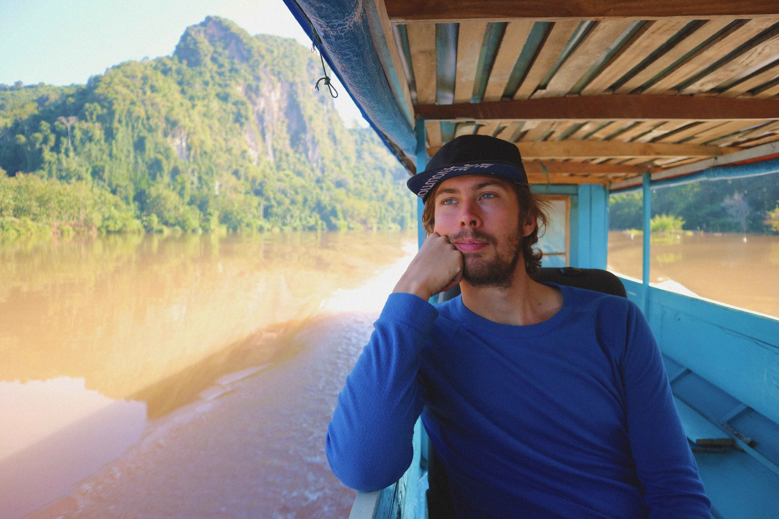 Mark chilling on a boat ride from Nong Khiaw