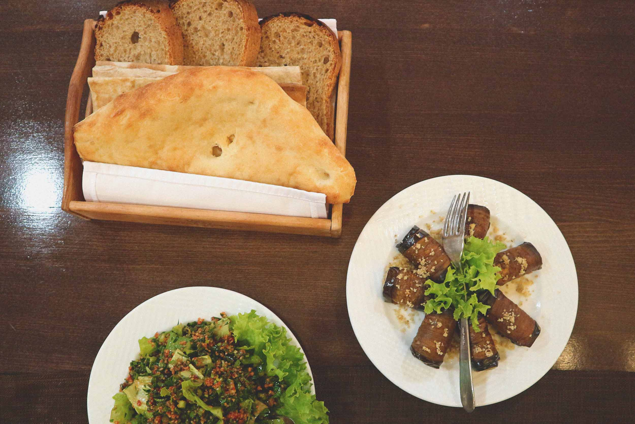 Homemade breads, Tabouleh salad and stuffed aubergines