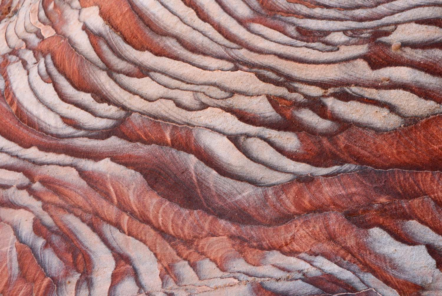 Jordan, Petra - layered coloured sand pattern