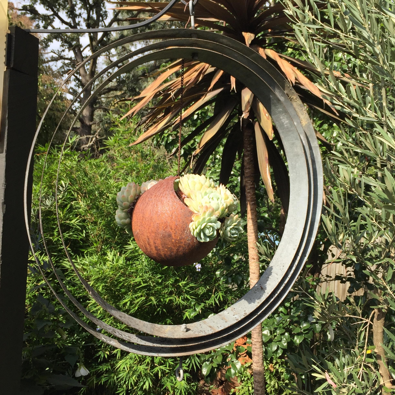 Wine Barrel Rings Into Garden Art